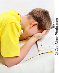 Tired Kid with a Books - Tired Teenager doing Homework at...