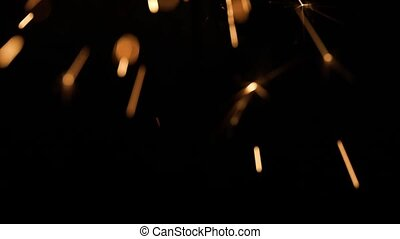 Lightening sparkler against dark background - Lightening...