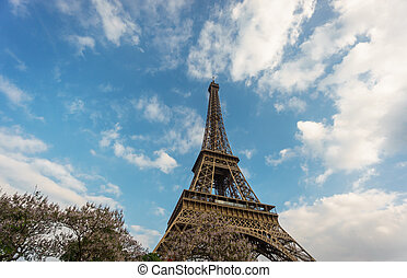 The Eiffel Tower against clouds and sky in Paris, France