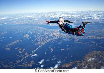 Skydiver falls through the air