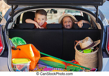 kids in car arriving at summer vacation - excited kids in...