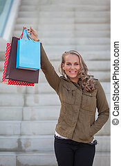 woman shopper with shopping bags