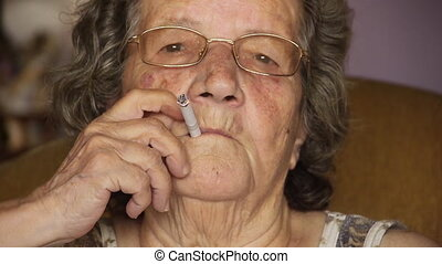 Old retired woman smoking cigarette - Unhealthy - Lifestyle...