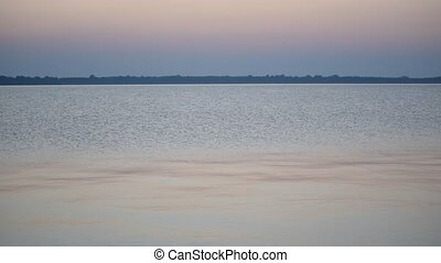 Calm smooth water surface of lake or river