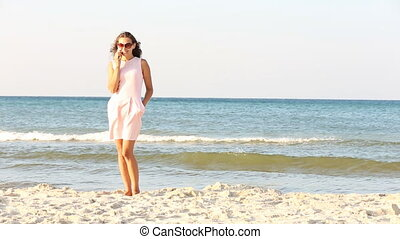 woman talking on the phone at the sea