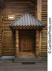 Wooden door with canopy over porch, detail of renovated...