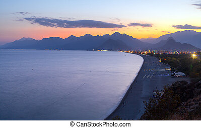 Beach at Antalya Turkey sunset - travel background - Beach...