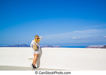 visiting the of the famous white island of Santorini in...