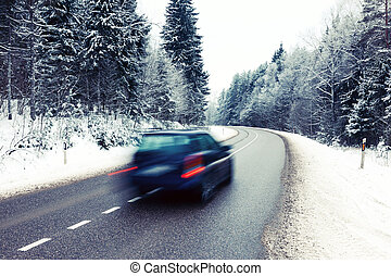 Lonely car on the road in winter landscape - Lonely car in...