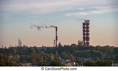 Smoke from Pipes of the Industrial Plant in the City. Time...