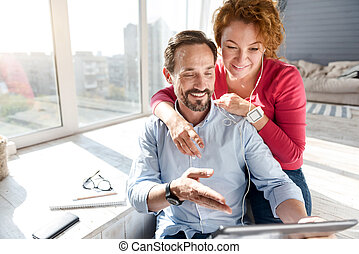 Man using tablet together with his wife
