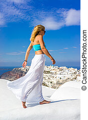 WOman on the rooftop in Santorini Greece - WOman on the...