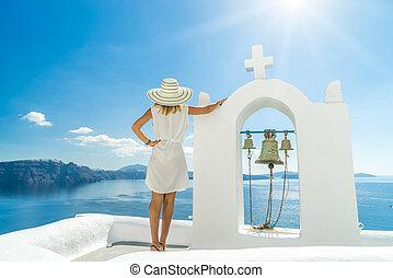 Young woman on holidays, Santorini Oia town Greece
