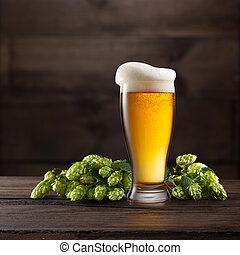 Still life with a glass of beer and hop. - Still life with a...