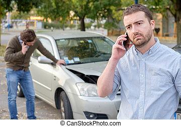 Man calling car mechanic insurance assistance after car accident