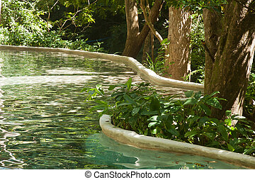 Hot spring pool in the jungle of costa rica