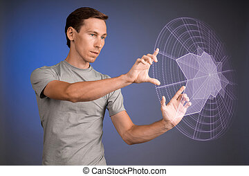 Man working with interactive Sci-Fi HUD interface. - Young...