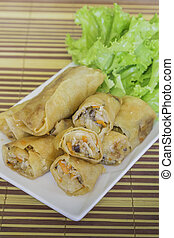fried spring rolls on a plate