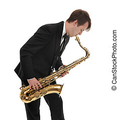 Saxophonist in a tuxedo plays music on sax. - Saxophonist in...