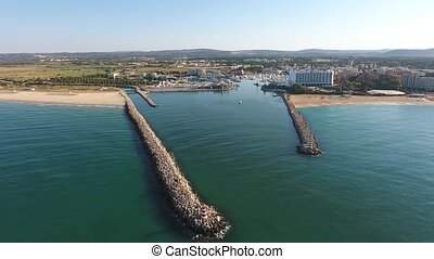 Flying over the entrance to the Marina dock. Vilamoura...