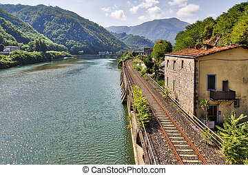 railroad along the river Serchio and Apuan Alps, Tuscany,...