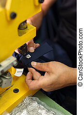 Studded  buttons - Seamstress sewing on buttons trouser