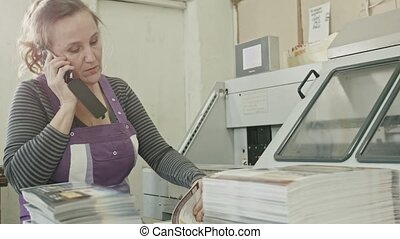 Polygraph printing process - a woman speak telephone and...