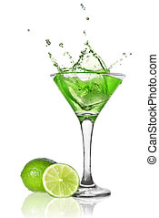 Green alchohol cocktail with splash and green lime isolated...