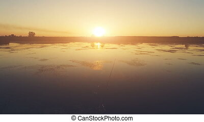 Flight over the woman fishing. - Aerial View: Flight over...