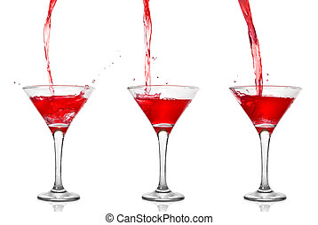 Martini cocktail with pouring into glass isolated on white