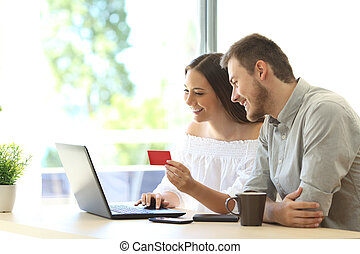 Buyers buying online with credit card - Couple of buyers...