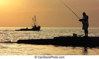 Fishing at the sunset