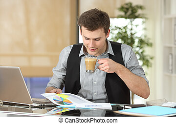Businessman reading growth graph at office - Businessman...