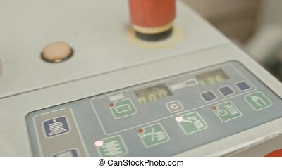 Folding machine on printing polygraph industry - red button and conveyer, close up