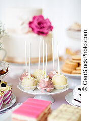 Cake pops on cakestand and various cakes . Candy bar. -...