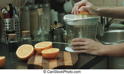Woman makes orange fresh - Close-up shot of the woman makes...