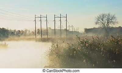 Fog with sun light at frosty morning river - Fog with sun...