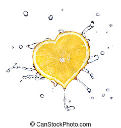 heart from lemon dropped into water isolated on white