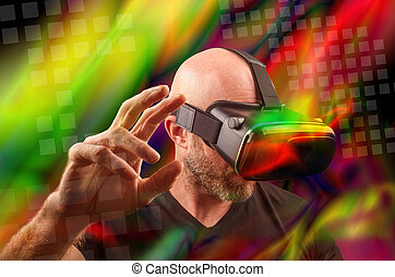 Man wearing VR headset and touching something with his hands...