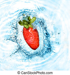 Strawberry dropped into blue water with splash. Top view