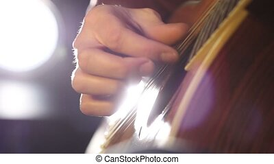 Detail of a guitarist playing classical guitar - Close up of...