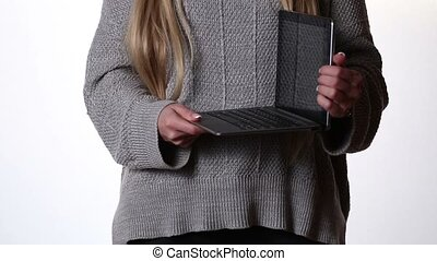Woman showing advantage of transformer book - Woman holding...