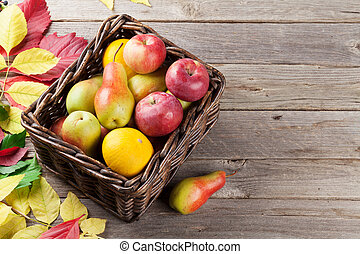 Autumn colorful leaves and food - Autumn fruits box and...