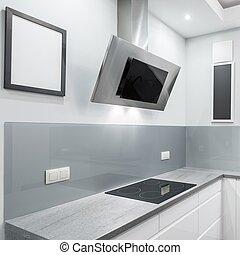 Steel exhaust hood - Kitchen with granite countertop,...
