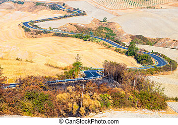 Country road and hills in Crete Senesi Tuscany