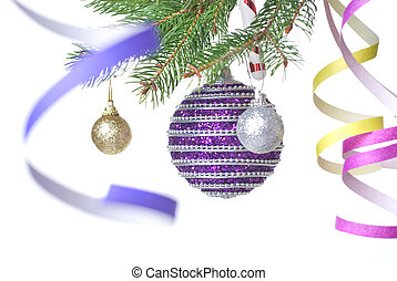 Christmas balls and decoration on fir tree branch isolated...