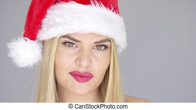 Close up portrait of beautiful blond girl in Santa Claus Hat