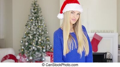 Adorable blond girl in christmas hat in her home - Adorable...