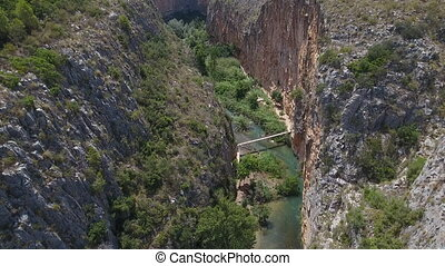 Ascending over deep gorge and suspension bridges in Chulilla...