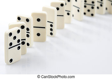 Dominoes standing in a row